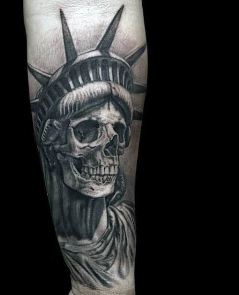Tattoo Of Skull Face Statue Of Liberty On Mens Wrist