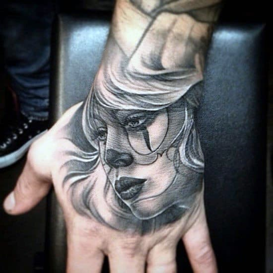 Portrait Face Tattoo On Hand