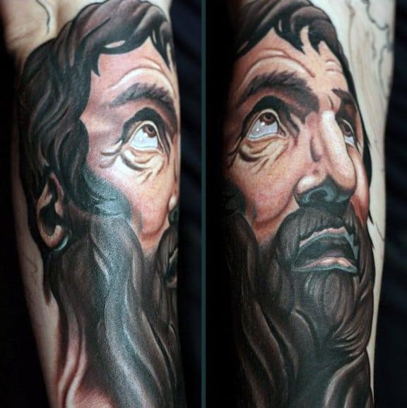Tattooed Christian On Man