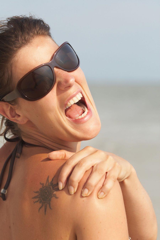 Tattooed Woman With Sunburn