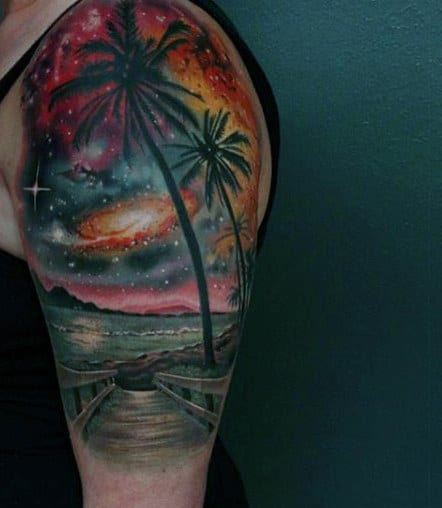Tattoos Of The Ocean And Beach On Guys Arm