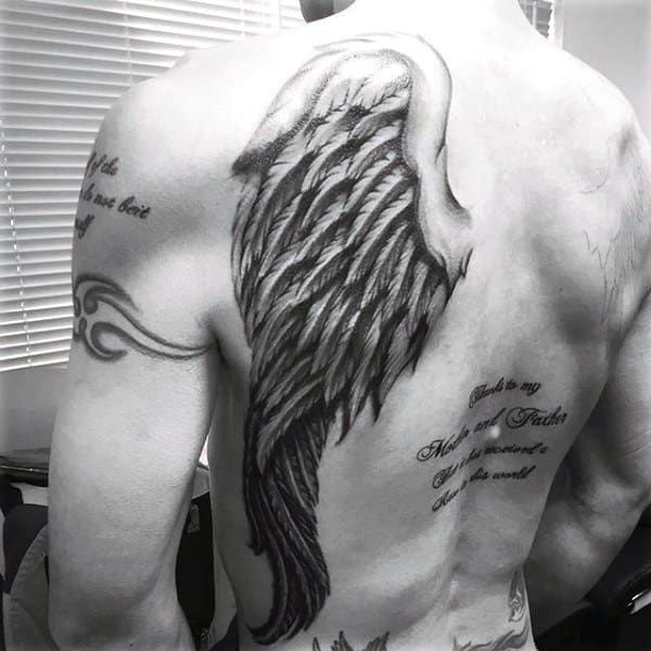 Tattoos Of Wings On Mans Back