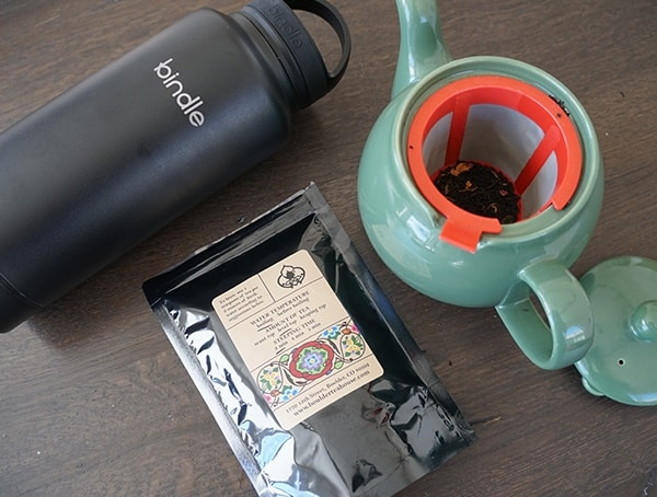Teapot With Tea And Black Bindle Bottle