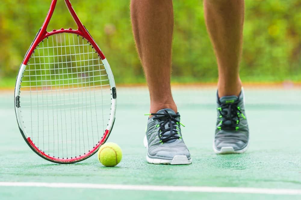playing tennis wearing tennis shoes