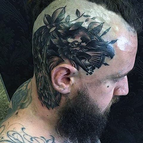 Thick Featherd Black Raven Tattoo On Mens Tonsured Head