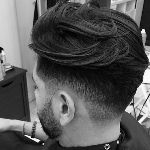 Thick Trendy Mens Hairstyle With Low Fade