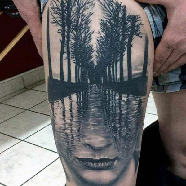 Thigh Abstract Face And Water Tattoo For Men