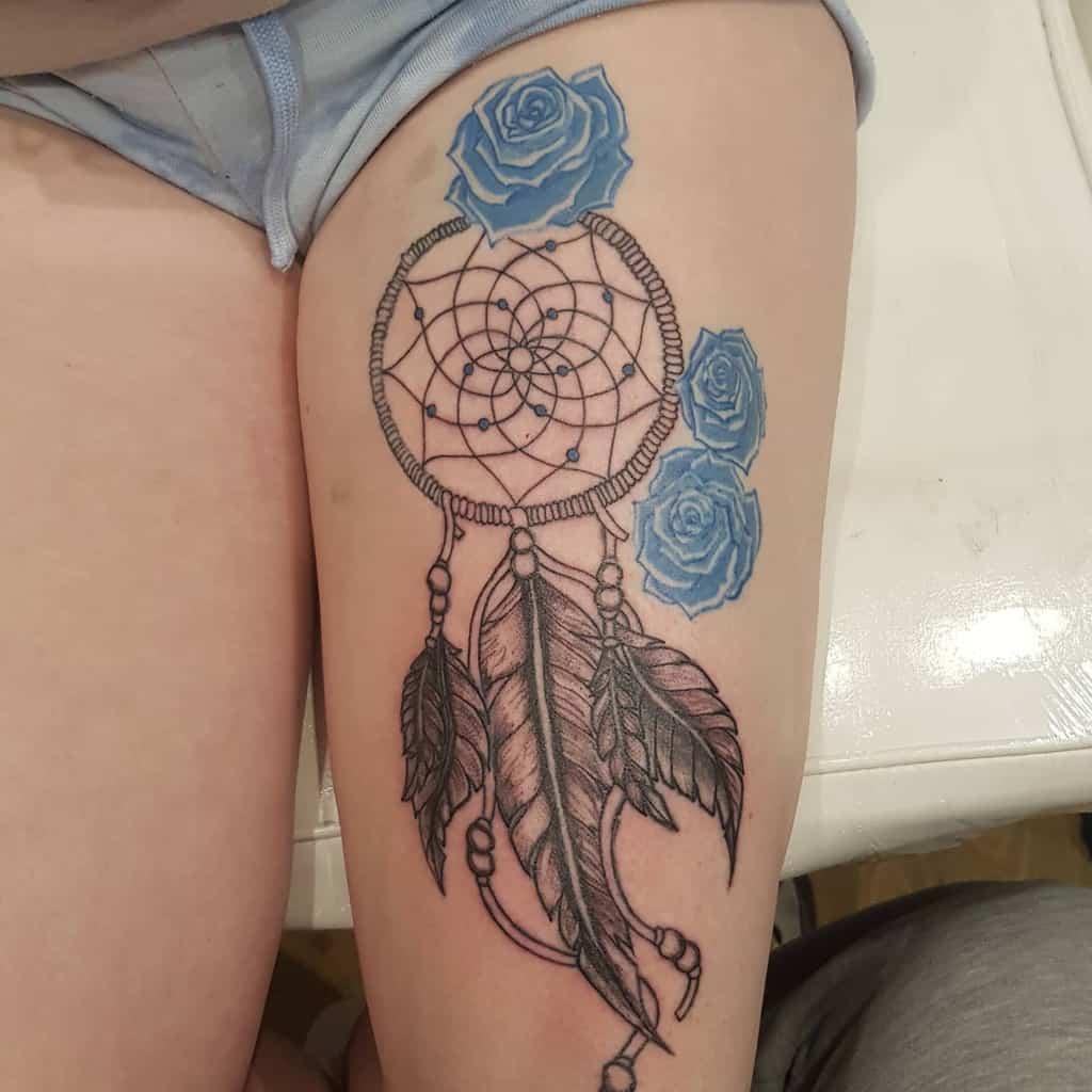thigh blue rose tattoos venominktattoostudiouk