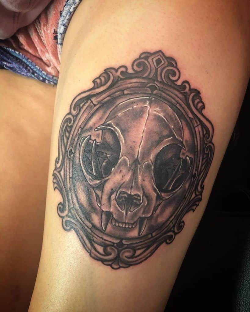 thigh cat skull tattoo nasr one
