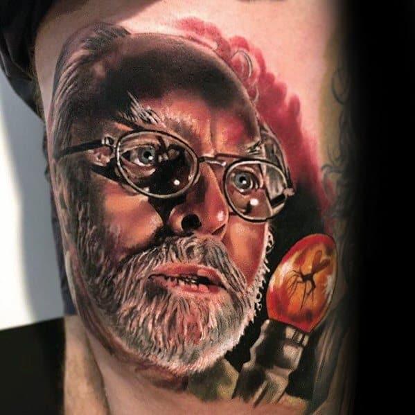 Thigh Male 3d Realistic Tattoo With Jurassic Park John Hammond Portrait Design