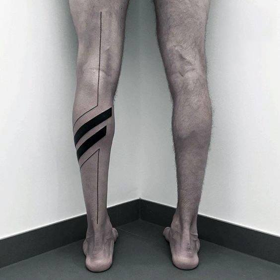 Thin And Bold Lines Guys All Black Back Of Leg Tattoo