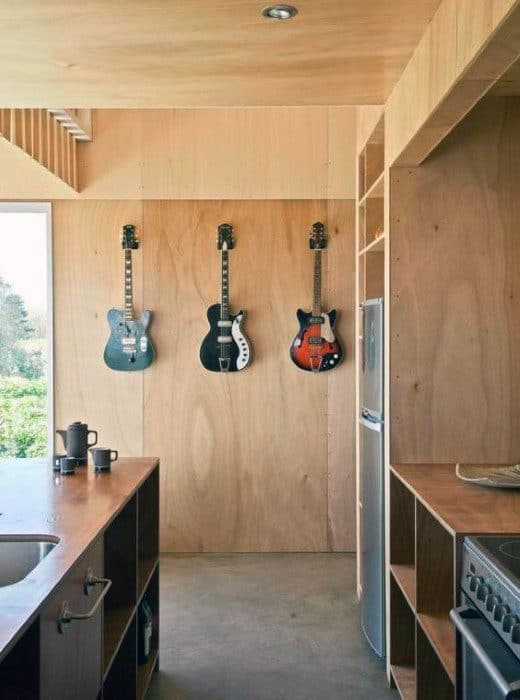 Three Guitars Hung On Plywood Wall Bachelor Pad Decor