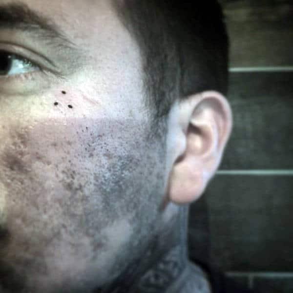 Three Tiny Dots Mens Face Tattoos