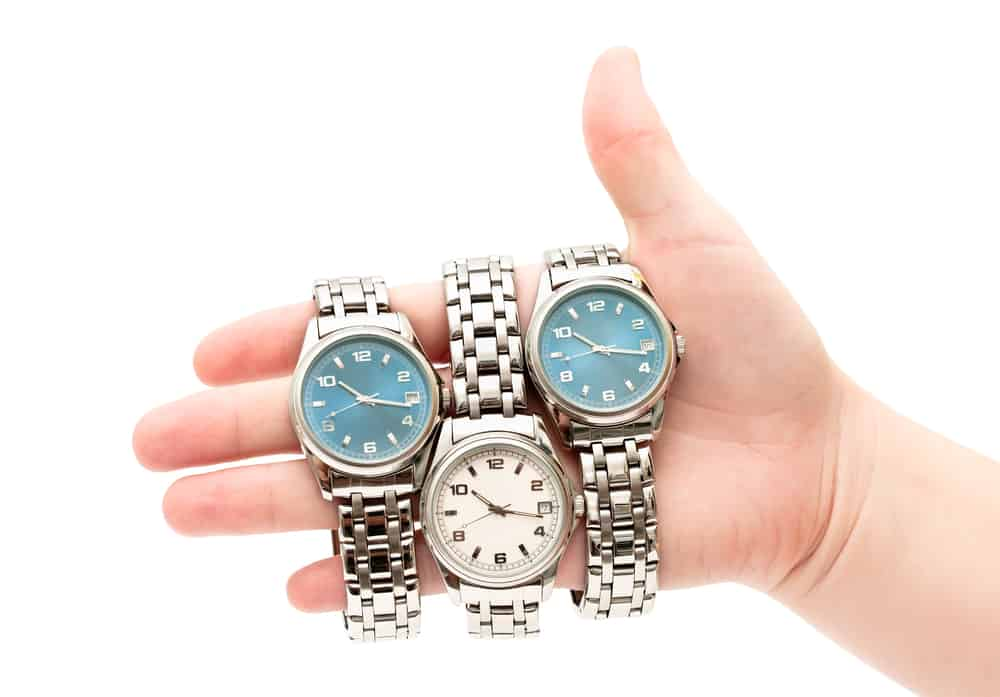 three different wristwatches on womens hand