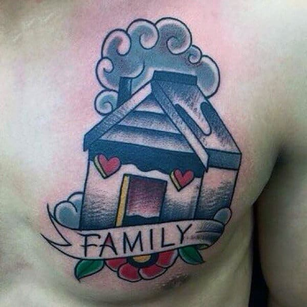 Tiny Cottage With Family Banner Tattoo Guys Chest