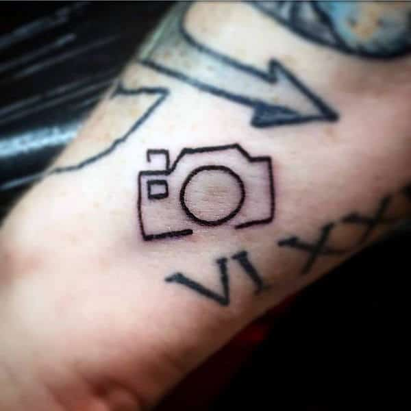 Tiny Pencil Outline Of Camera Tattoo Male Forearms