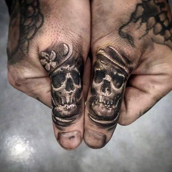 Tiny Skulls Guys Different Shaded Finger Tattoos