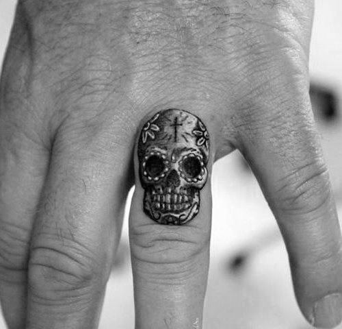 tiny-small-day-of-the-dead-finger-skull-tattoo-for-guys