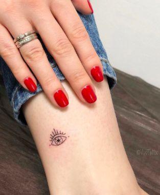 Tiny Third Eye Tattoo