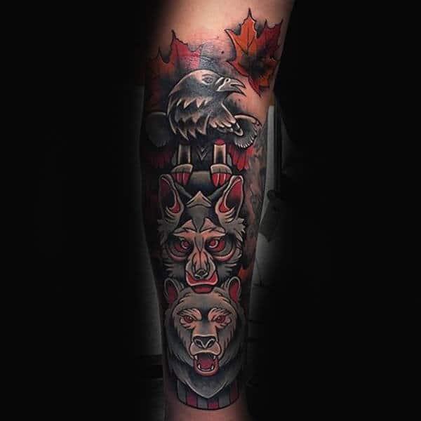totem-pole-of-animals-maple-leaf-guys-forearm-sleeve-tattoo