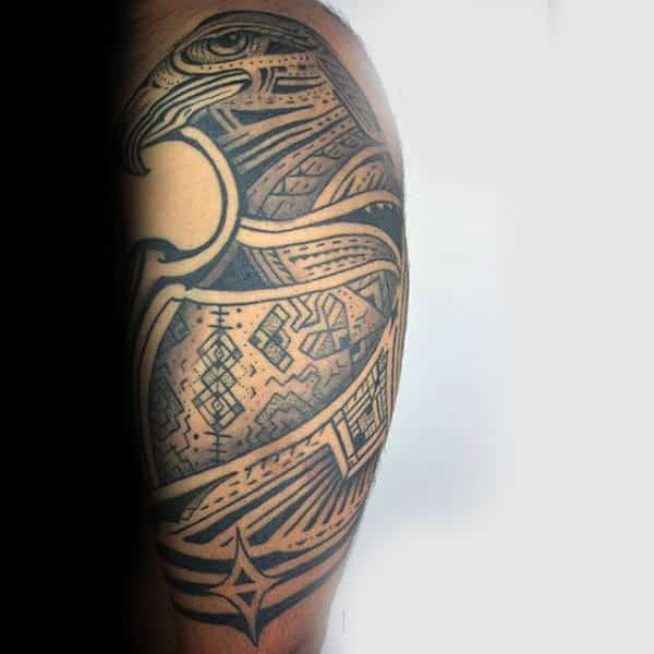 Totem Style Upper Arm Hawk Tattoo For Guys