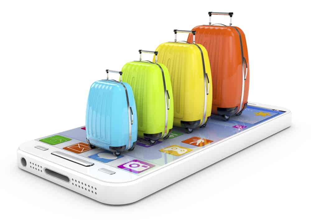 tourism concept smartphone with colored bags on display