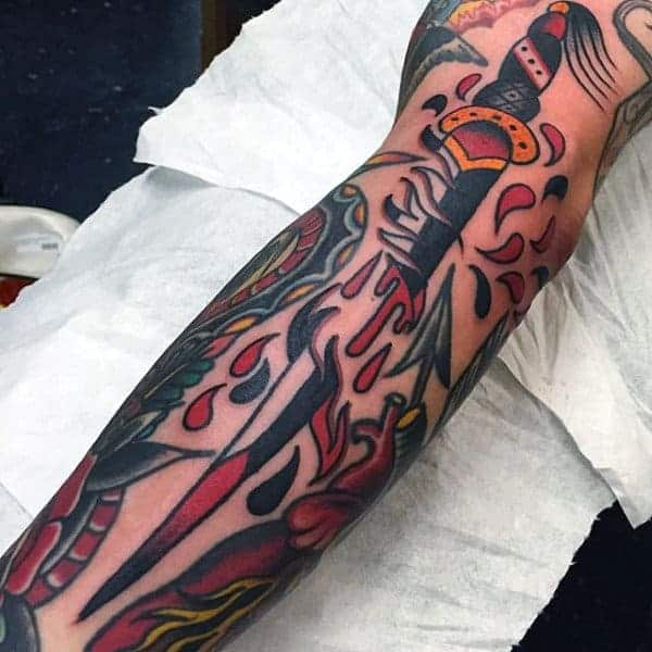 traditional-american-tattoo-of-knife-sliced-in-two-guys-forearms