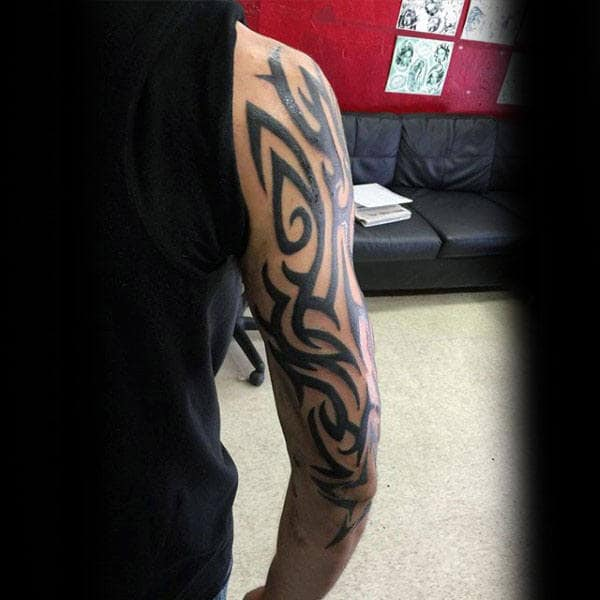 Traditional Arm Male Tribal Tattoo Design Ideas With Black Ink