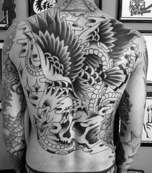 Traditional Black Ink Flying Eagle Skull Male Back Tattoo