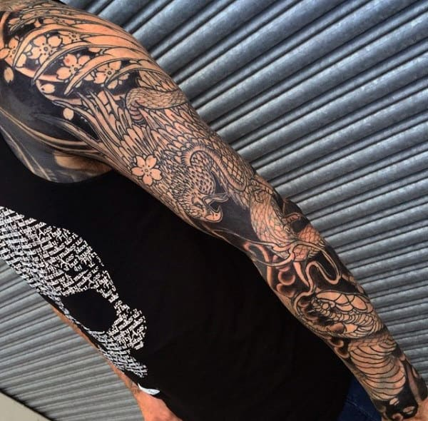 Traditional Black Ink Hawk Fighting Coiled Snake Tattoo On Male Full Sleeve