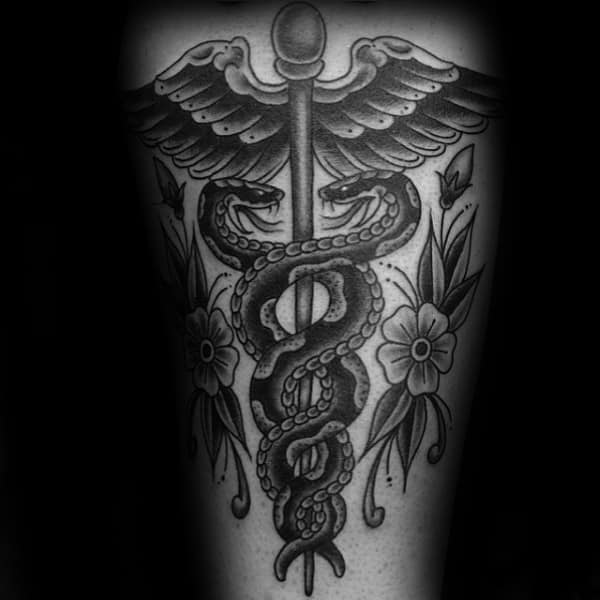Traditional Caduceus With Flowers Mens Back Tattoo Ideas