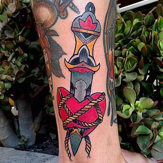 Traditional Dagger Through Heart Guys Lower Leg Tattoos