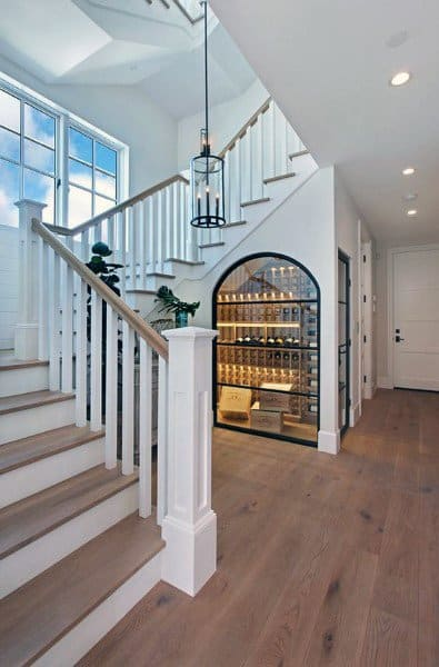 Traditional Designs For Staircases With Built In White Cellar