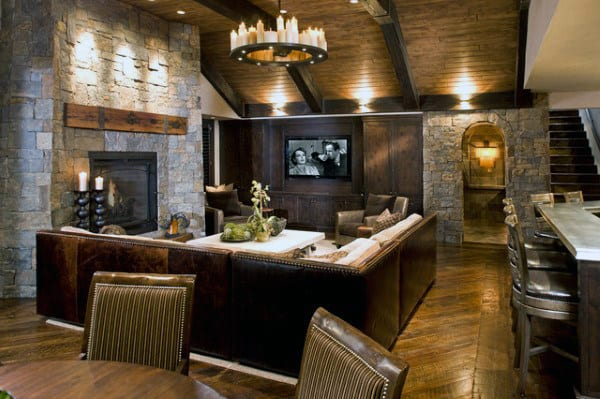 Traditional Finished Basement With Stone Walls And Hardwood Flooring