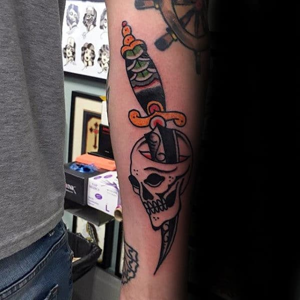 Traditional Forearm Skull With Dagger Tattoo Ideas For Men
