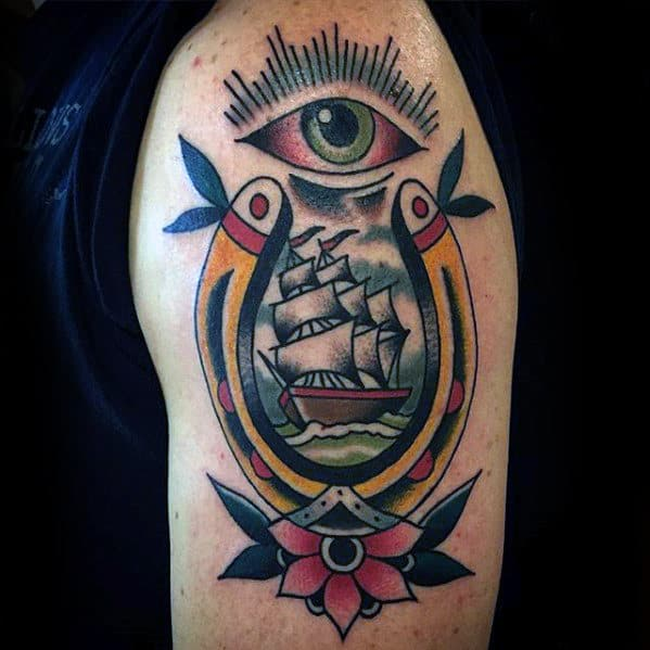 Traditional Guys Ship With Horseshoe And All Seeing Eye Arm Tattoo