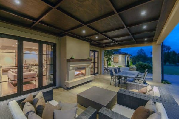 Traditional Home With Outdoor Fireplace And Patio Seating