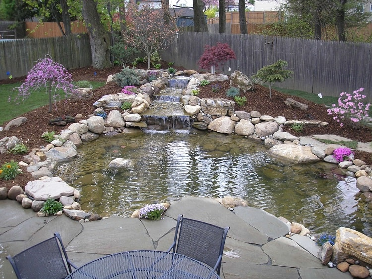Traditional Large Backyard Pond Sitting Area