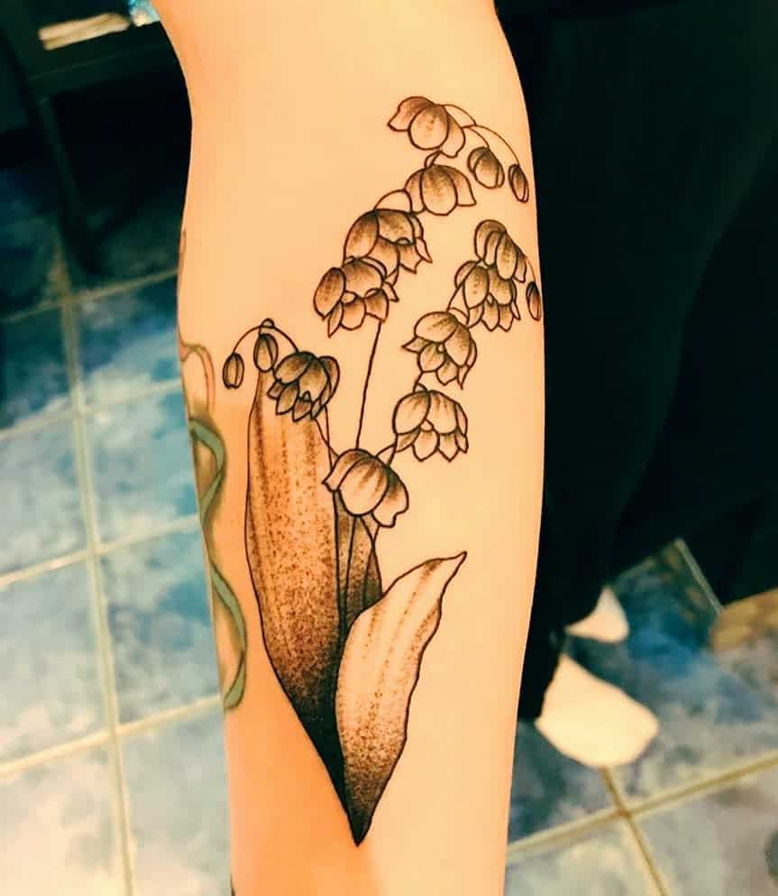 traditional-lily-of-the-valley-tattoo-beyond_ink83