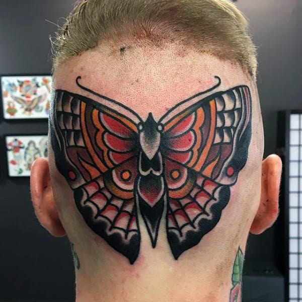 Traditional Moth Tattoo On Mans Back Of Head