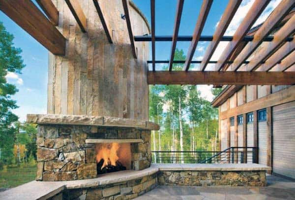 Traditional Natural Cut Stone Outdoor Fireplace With Terrace