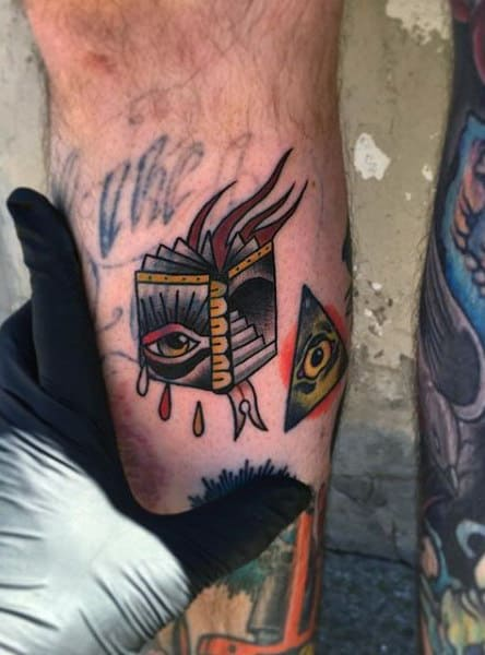 Traditional One Eyed Book Tattoo Guys Forearms