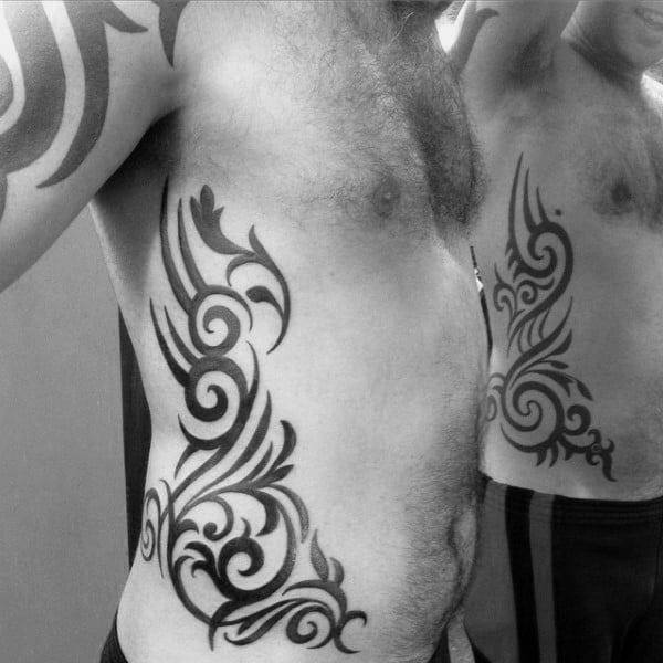 Traditional Ornate Mens Tribal Rib Black Ink Tattoos