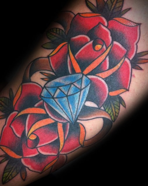 4b96ab4cc Traditional Rose Flowers With Blue Diamond Mens Inner Arm Bicep Tattoo