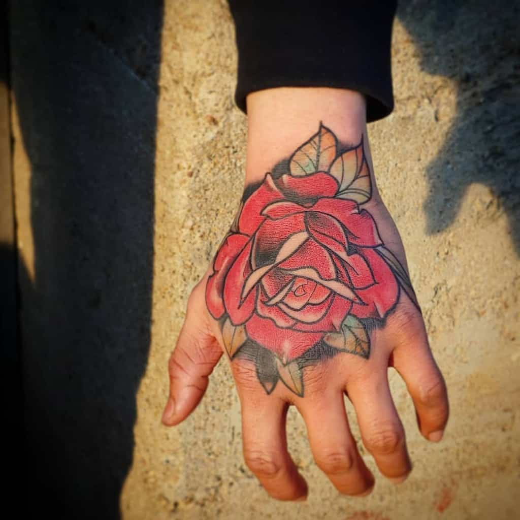 traditional rose hand tattoos tatasaurus_rex