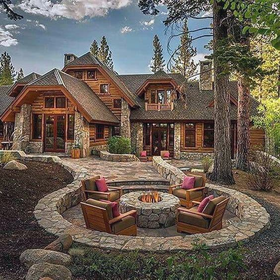 Traditional Stone Patio With Circle Outdoor Fire Pit And Lounge Chairs