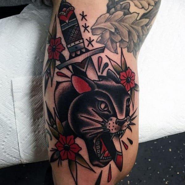 Traditional Tattoo Of Knife Through A Dark Feline Men Forearms