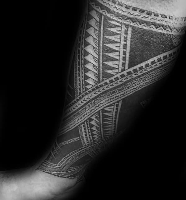 Traditional Tattoo Of Samoan Tribal Design On Guys Lower Legs