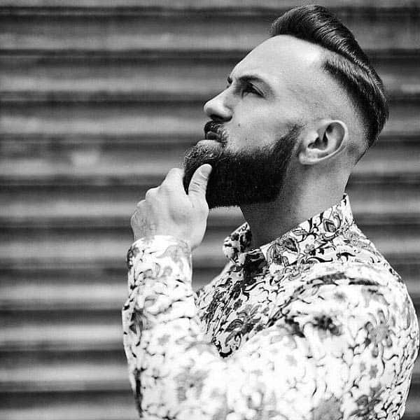 Trendy Modern Hard Part Haircut For Gentlemen With Shaved Sides
