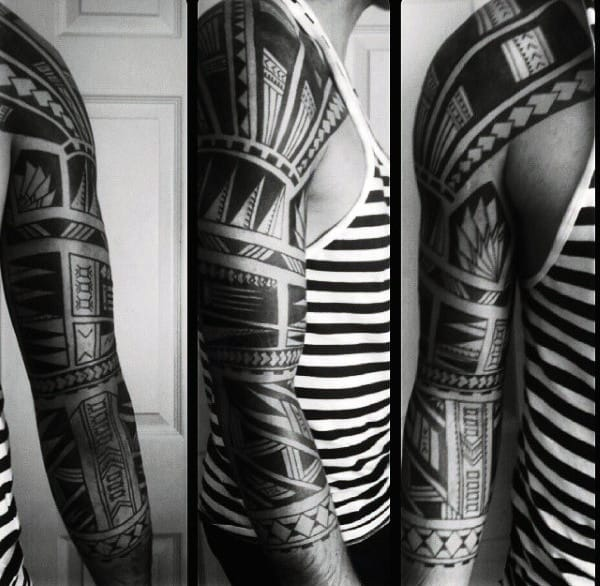 Tribal Arm Sleeve Tattoo On Man